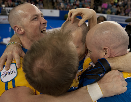 Team Alberta celebrates its Tim Hortons Brier on Sunday. (Photo, CCA/Michael Burns)