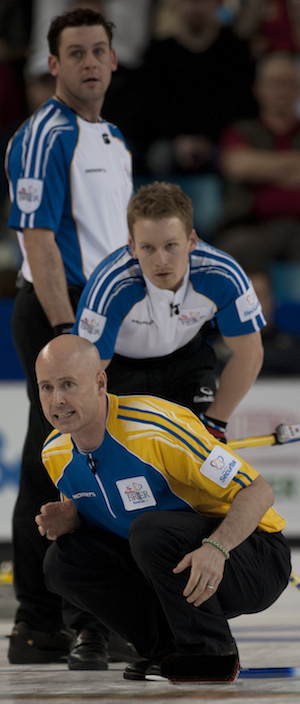 Kevin Koe watches his shot as B.C.'s Rick Sawatsky, top, and Tyrel Griffith look on. (Photo, CCA/Michael Burns)