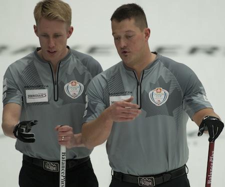 Marc Kennedy, left, and Ben Hebert discuss shot options. (Photo, CCA/Michael Burns)