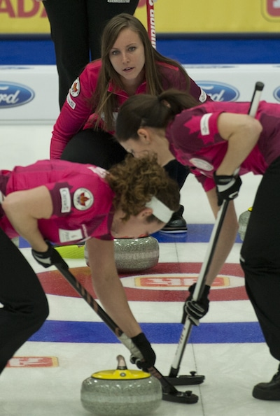 Rachel Homan, top, instructs sweepers Joanne Courtney, left, and Lisa Weagle. (Photo, CCA/Michael Burns)