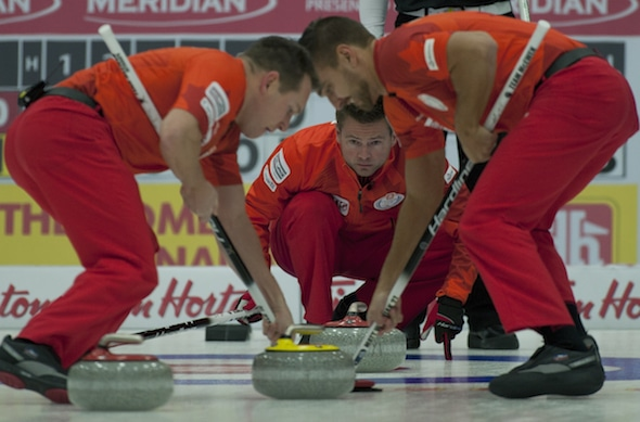 Mike McEwen, centre, guides sweepers Denni Neufeld, left, and Matt Wozniak. (Photo, CCA/Michael Burns)