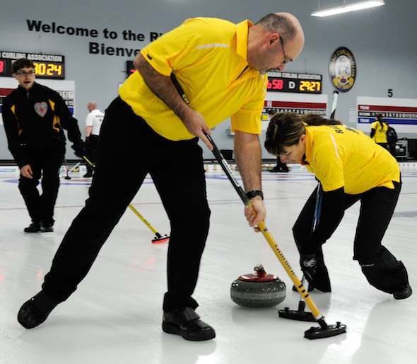 New Brunswick third Marcel Robichaud, left, guides sweepers Lloyd Morrison, middle, and Marie Richard during Wednesday's game at the Canadian Mixed. (Photo, CCA/Claudette Bockstael, Studio C Photography)