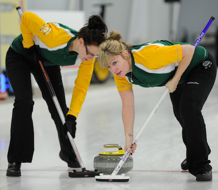 Northern Ontario sweepers Alissa Begin, left, and Lindsay Miners scrub a rock during Sunday afternoon's game. (Photo, CCA/Claudette Bockstael, Studio C Photography)