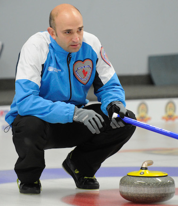 Quebec skip Mike Fournier ponders the situation on Sunday night.  (Photo, CCA/Claudette Bockstael, Studio C Photography)