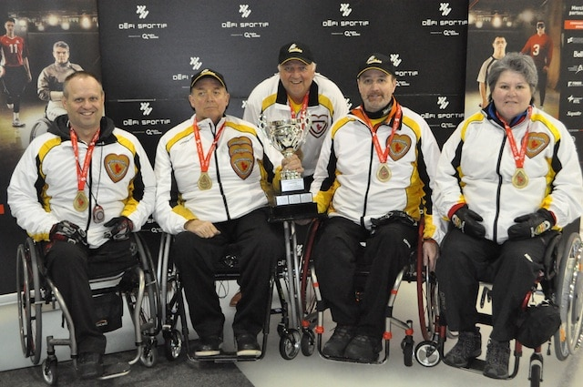 2014 Canadian Wheelchair Curling Champions, Manitoba: Dennis Thiessen, Mark Wherret, coach Tom Wherrett, Jamie Anseeuw, Melissa Lecuyer (Photo Morgan Daw)