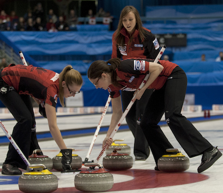 Team Canada skip Rachel Homan, top, instructs sweepers Alison Kreviazuk, left, and Lisa Weagle. (Photo, CCA/Michael Burns)