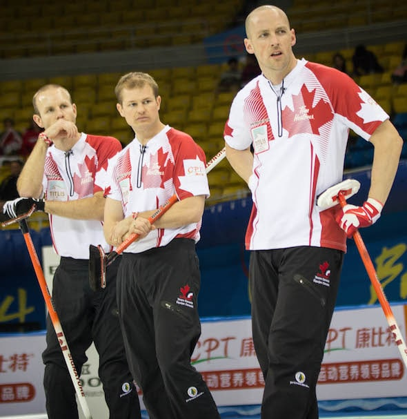 Nolan Thiessen, right, isn't just a great lead. He's also a great planner, who has the major responsibility of keeping Team Canada's books in order, as well as making sure second Carter Rycroft, centre, makes it on time for flights. (Photo, World Curling Federation/Richard Gray)