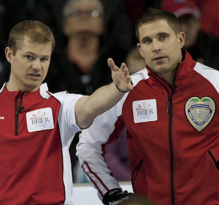 Team Canada second Carter Rycroft, left, discusses strategy with skip John Morris. (Photo, Curling Canada/Michael Burns)
