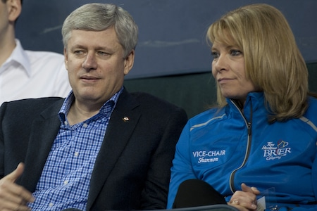Tim Hortons Brier host committee vice-chair Shannon Kleibrink, right, watches Saturday's opening draw with note curling fan (and, yes, Prime Minister of Canada) Stephen Harper. (Photo, Curling Canada/Michael Burns)