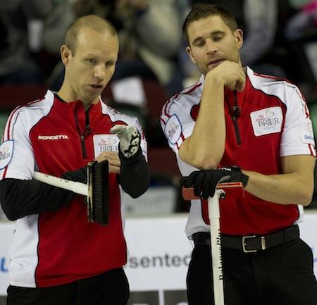 Team Canada's Pat Simmons, left, and John Morris discuss shot options. (Photo, Curling Canada/Michael Burns)