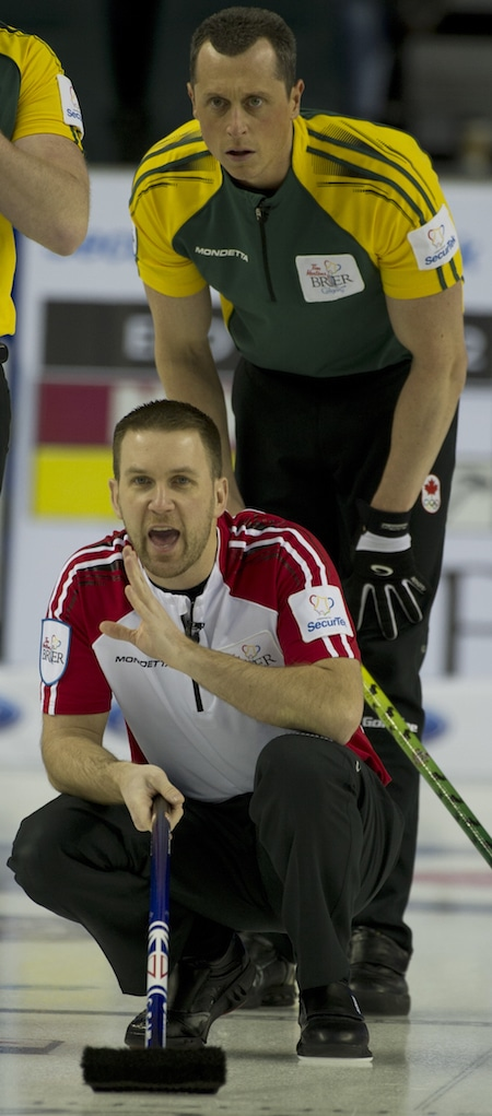 Newfoundland/Labrador skip Brad Gushue calls instructions to his sweepers, with Northern Ontario's E.J. Harnden looking on. (Photo, Curling Canada/Michael Burns)
