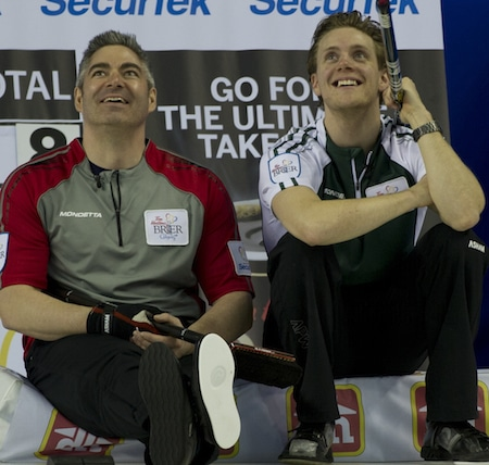 Northwest Territories vice Mark Whitehead, left, and P.E.I. skip Adam Casey have a laugh together on Thursday. (Photo, Curling Canada/Michael Burns)