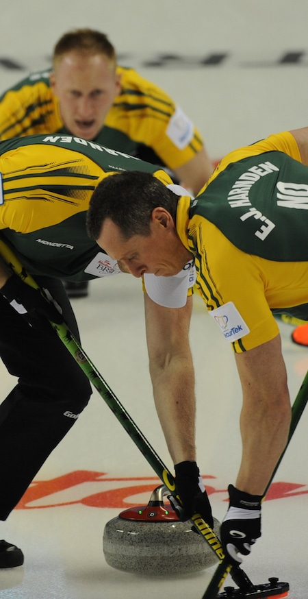 Ryan Harnden, left, and E.J. Harnden sweep for Northern Ontario skip Brad Jacobs. (Photo, Curling Canada/Michael Burns)