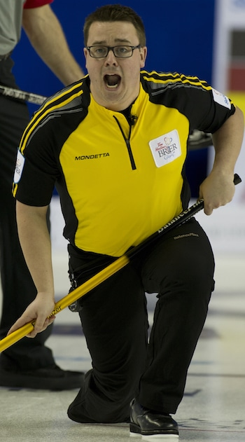 New Brunswick skip Jeremy Mallais encourages his sweepers in Saturday night's win over the Northwest Territories. (Photo, Curling Canada/Michael Burns)