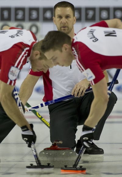 Newfoundland/Labrador skip Brad Gushue watches as sweepers Geoff Walker, left, and Brett Gallant go to work. (Photo, Curling Canada/Michael Burns)