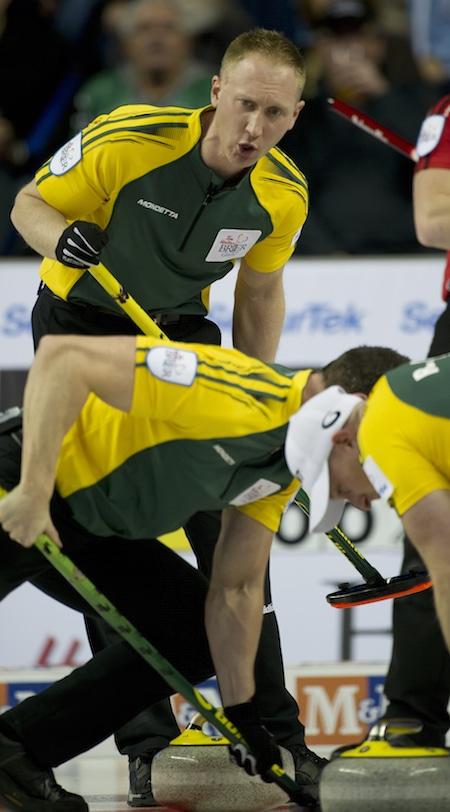 Northern Ontario skip Brad Jacobs guides sweepers E.J. Harnden, left, and Ryan Harnden. (Photo, Curling Canada/Michael Burns)