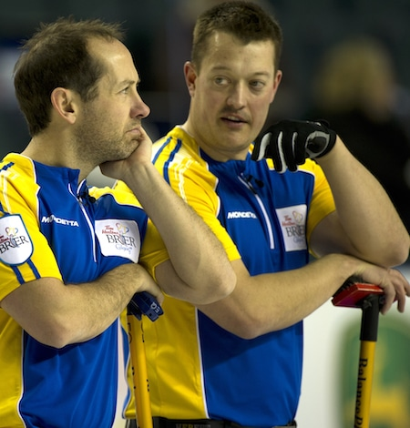 Alberta's Brent Laing, left, and Ben Hebert ponder the situation on Tuesday. (Photo, Curling Canada/Michael Burns)