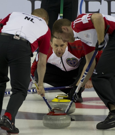 Newfoundland/Labrador skip Brad Gushue calls line for sweepers Mark Nichols, left, and Geoff Walker. (Photo, Curling Canada/Michael Burns)