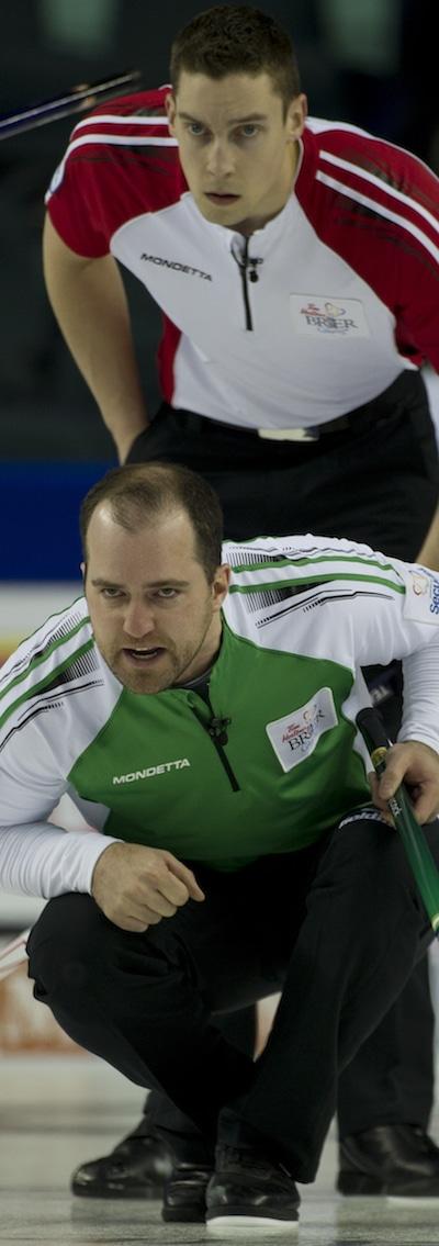 Saskatchewan skip Steve Laycock guides his sweepers as Newfoundland/Labrador second Brett Gallant looks on. (Photo, Curling Canada/Michael Burns)