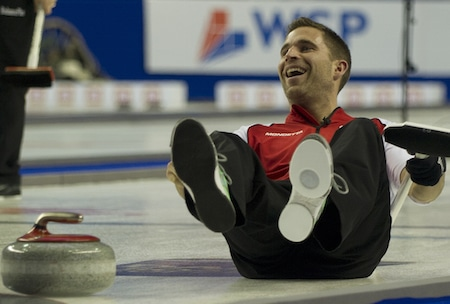 Team Canada vice-skip John Morris takes a tumble during the sixth end. (Photo, Curling Canada/Michael Burns)