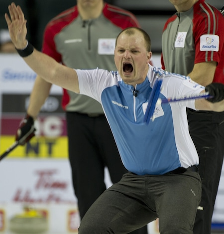 Quebec vice-skip Martin Crête apparently didn't want his sweepers to sweep. But we could be wrong. (Photo, Curling Canada/Michael Burns)