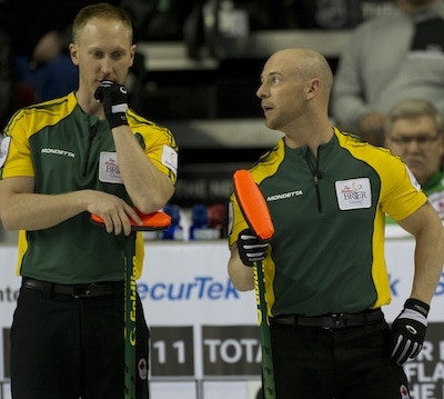 Northern Ontario's Brad Jacobs, left, and Ryan Fry discuss their options. (Photo, Curling Canada/Michael Burns)