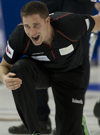 Team Canada skip John Morris shouts instructions to sweepers. (Photo, CCA/Michael Burns)