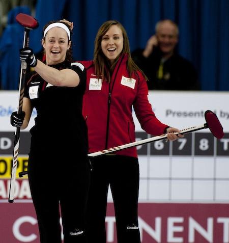 Team Canada's Joanne Courtney and Rachel Homan celebrate a made shot. (Photo, CCA/Michael Burns)