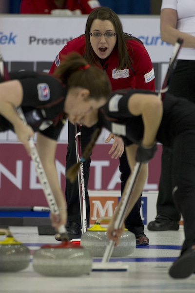 Team Canada skip Val Sweeting instructs her sweepers during Saturday night's win. (Photo, CCA/Michael Burns)