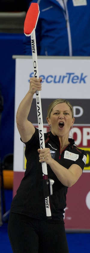 Team Canada's Lori Olson-Johns salutes teammate Pat Simmons. (Photo, CCA/Michael Burns)