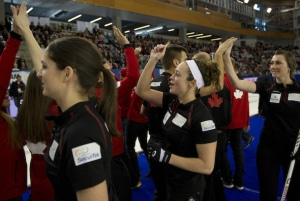 Team Canada players celebrate their clinching points on Sunday. (Photo, CCA/Michael Burns)