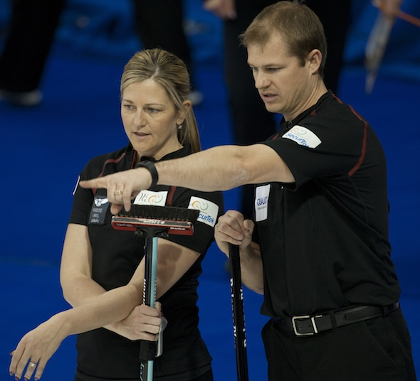 Team Canada's Carter Rycroft, right, and Lori Olson-Johns discuss options during their mixed doubles triumph. (Photo, CCA/Michael Burns)