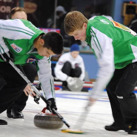Saskatchewan sweepers Brady Kendel, left, and Brandon Leippi go to work on Sunday. (Photo, Amanda Rumboldt)