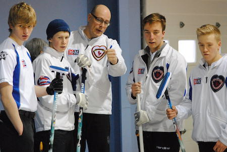 Team B.C. coach Todd Troyer (middle) discusses options with the players. (Photo, Amanda Rumboldt)