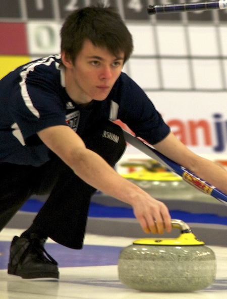 Nova Scotial lead Alec Cameron delivers rock during his team's win over Newfoundland/Labrador. (Photo, Amanda Rumboldt)