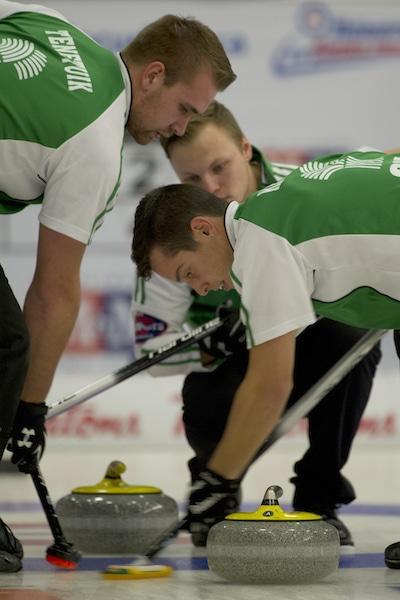 Saskatchewan skip Jacob Hersikorn watches as sweepers Cole Tenetiuk, left, and Brady Kendel keep things clean. (Photo, CCA/Michael Burns)