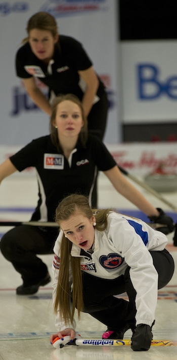 B.C. skip Corryn Brown, front, urges on her sweepers. (Photo, CCA/Michael Burns)