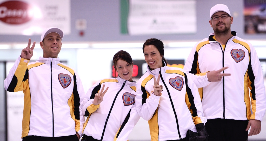 Manitoba's Kyle Einarson, Kerri Einarson, Jennifer Clark-Fouire and Jared Kolomaya celebrate after an exciting win in Draw 10 at the 2015 Canadian Mixed Curling Championship in North Bay, Ont. (Brian Doherty Photography)