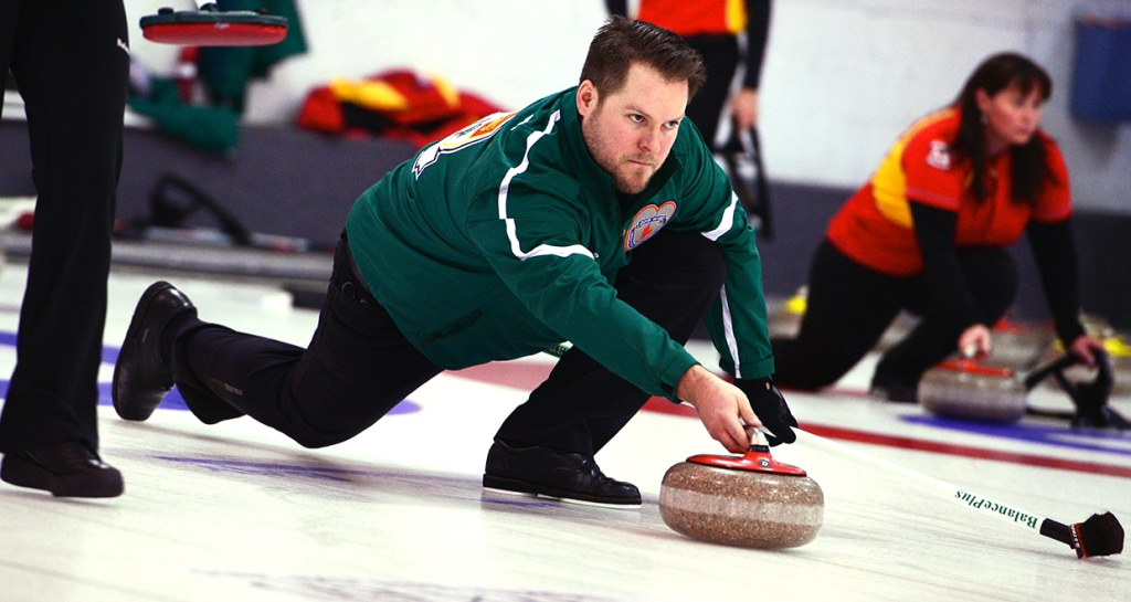 PEI skip Jamie Newson delivers his stone on the way to a dramatic extra-end victory in Draw 7 action at the North Bay Granite Club (Brian Doherty Photography)