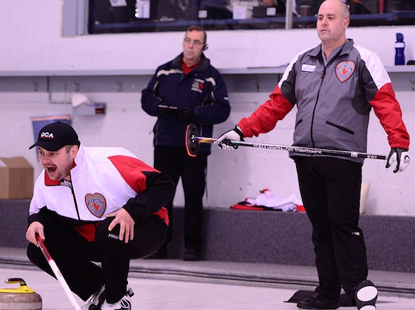 Territories skip Jamie Koe, right, watches closely as Ontario skip Chris Gardner calls line instructions during the semifinal. (Brian Doherty Photography)