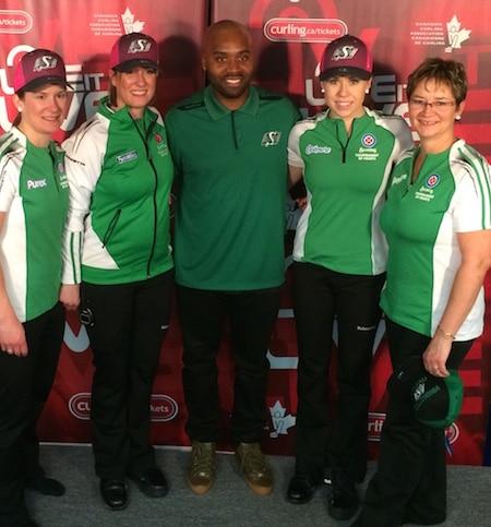 New Saskatchewan Roughriders coach Kevin Glenn poses with Team Saskatchewan, from left, Marliese Miller, Stefanie Lawton, Stephanie Schmidt and Sherry Anderson.