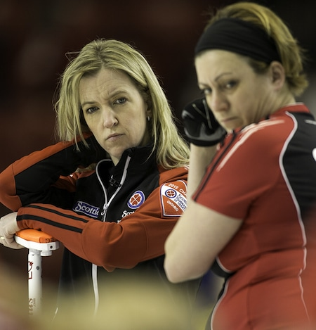 Ontario skip Julie Hastings and lead Katrina Collins look over the house during action on Wednesday. (Photo, CCA/Andrew Klaver)