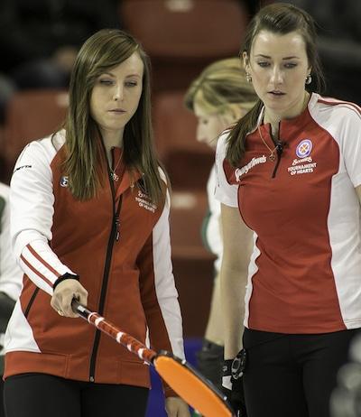 Team Canada's Rachel Homan, left, discusses strategy with Emma Miskew. (Photo, CCA/Andrew Klaver)