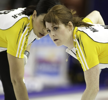 Jill Officer and Dawn McEwen sweep a Team Manitoba rock on Thursday. (Photo, CCA/Andrew Klaver)