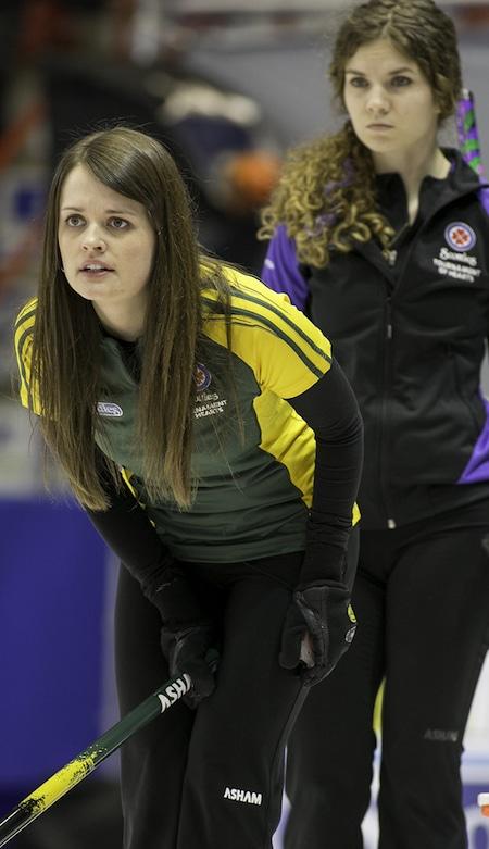 Northern Ontario skip Tracy Horgan, left, assesses the situation as Yukon skip Sarah Koltun looks on. (Photo, CCA/Andrew Klaver)
