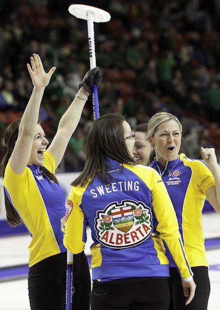 Team Alberta, from left, Rachelle Brown, Val Sweeting, Dana Ferguson and Lori Olson-Johns celebrate their win on Saturday. (Photo, CCA/Andrew Klaver)