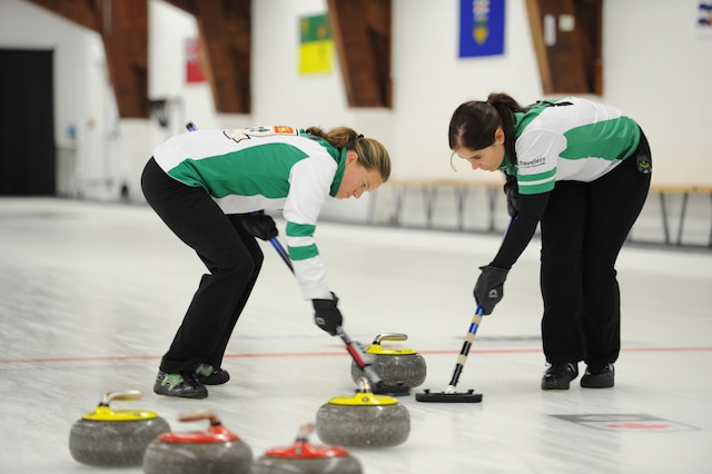 PEI sweepers in action at the 2015 Travelers Curling Club Championship (Curling Canada/Claudette Bockstael Photo)