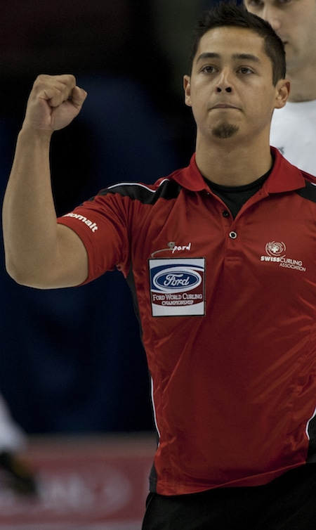 Switzerland's Marc Pfister celebrates his win over Italy. (Photo, Curling Canada/Michael Burns)