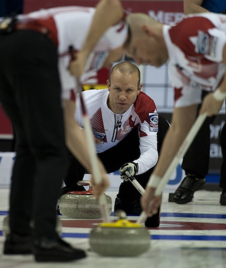 Team Canada's Pat Simmons checks watches closely. (Photo, Curling Canada/Michael Burns)