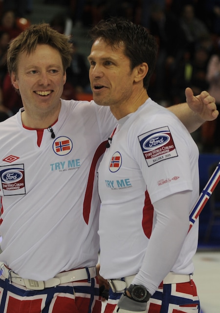 Norway's Thomas Ulsrud, right, celebrates Friday's win with Torger Nergård. (Photo, Curling Canada/Michael Burns)